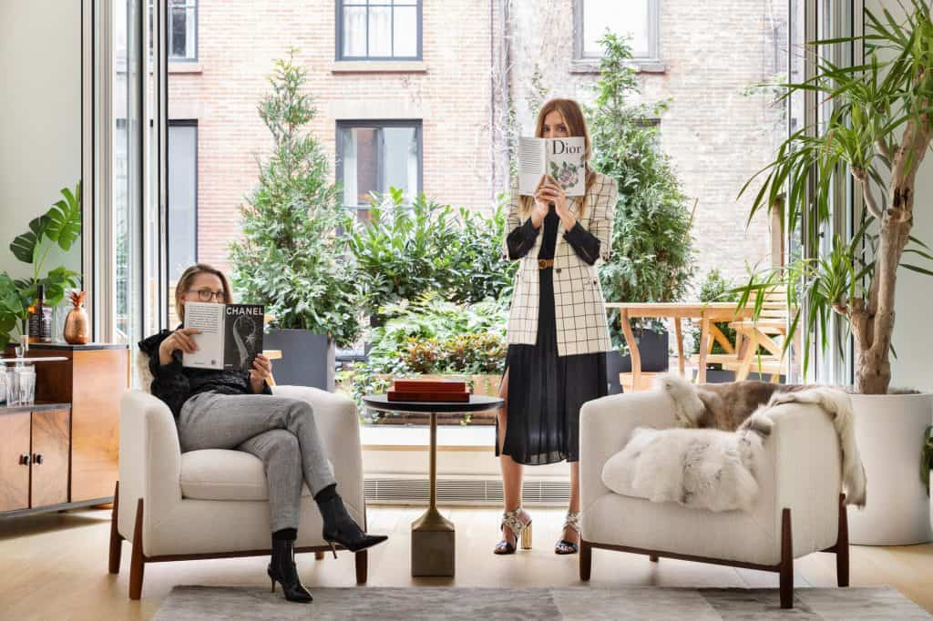 Women reading Real Estate Marketing Products